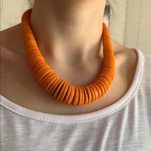 Orange disk necklace